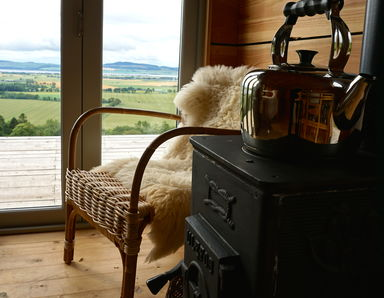 Wood burning stove to keep you warm and a view to stare at for hours on end