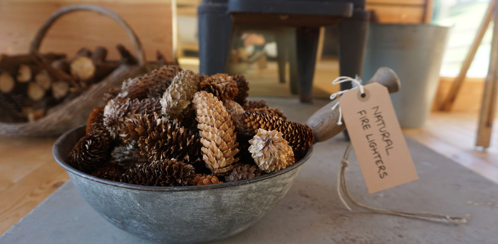 Wood burning stoves in each glamping hut with fir cones as natural fire lighters