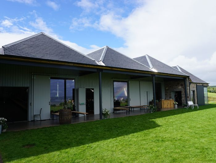 Cover outdoor area in front of Steading, level lawn extending from concrete